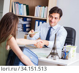 Customer visiting travel agency and talking to agent. Стоковое фото, фотограф Elnur / Фотобанк Лори