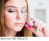 Купить «Woman working on her eyelashes in beauty concept», фото № 34153213, снято 29 января 2018 г. (c) Elnur / Фотобанк Лори
