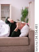 Old man suffering at home. Стоковое фото, фотограф Elnur / Фотобанк Лори