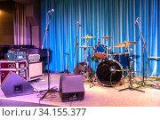Variety drum set and tube sound amplifier on the scene of a night club. Стоковое фото, фотограф Евгений Ткачёв / Фотобанк Лори