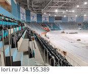 Купить «Строительство легкоатлетического спортивного комплекса в столице Казахастана Нур-Султане», фото № 34155389, снято 3 июля 2020 г. (c) Максим Гулячик / Фотобанк Лори