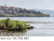 Купить «Panorama of a mountain lake and the city», фото № 34156481, снято 24 августа 2017 г. (c) Татьяна Ляпи / Фотобанк Лори