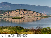 Купить «View of the lake Hemaditida (northwest Greece, Macedonia)», фото № 34156637, снято 27 августа 2017 г. (c) Татьяна Ляпи / Фотобанк Лори