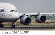 Купить «Lufthansa Airbus 380 taxiing before departure», видеоролик № 34156981, снято 19 июля 2017 г. (c) Игорь Жоров / Фотобанк Лори