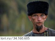 CHARISHSKOE. ALTAISKIY KRAI. WESTERN SIBERIA. RUSSIA - SEPTEMBER 15, 2016: Portrait of descendant of the Cossacks in the Altai, at the festival on September... Стоковое фото, фотограф Zoonar.com/Ruslan Olinchuk / easy Fotostock / Фотобанк Лори