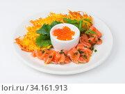 Plate with potato pancakes salmon fish and red caviar. Стоковое фото, фотограф Zoonar.com/Ruslan Olinchuk / easy Fotostock / Фотобанк Лори