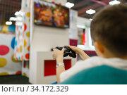 Купить «Boy plays a game console in entertainment center», фото № 34172329, снято 10 марта 2020 г. (c) Tryapitsyn Sergiy / Фотобанк Лори