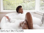 Купить «Woman relaxing in a bathtub», фото № 34172645, снято 17 октября 2019 г. (c) Wavebreak Media / Фотобанк Лори