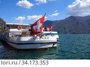 Купить «Lake Lugano on a spring sunny day. View of a passenger ship decorated with the Swiss flag. Lugano, canton of Ticino, Switzerland, Europe.», фото № 34173353, снято 17 апреля 2018 г. (c) Bala-Kate / Фотобанк Лори