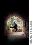 Silhouette of a man practicing karate moves in a dark tunnel. Стоковое фото, фотограф Zoonar.com/Pawel Opaska / easy Fotostock / Фотобанк Лори