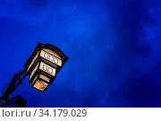 Street lamp lit at night in Ohrid town, Northern Macedonia. Стоковое фото, фотограф Zoonar.com/Pawel Opaska / easy Fotostock / Фотобанк Лори