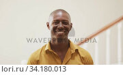 Young man smiling at home. Стоковое видео, агентство Wavebreak Media / Фотобанк Лори