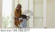 Father embracing his son at home. Стоковое видео, агентство Wavebreak Media / Фотобанк Лори