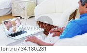 Купить «Senior couple having a video chat on their laptop at home», видеоролик № 34180281, снято 26 июня 2020 г. (c) Wavebreak Media / Фотобанк Лори