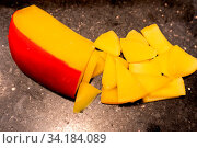 Купить «Edam cheese on black stone plate in buffet line», фото № 34184089, снято 9 июля 2020 г. (c) easy Fotostock / Фотобанк Лори