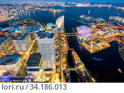 Купить «Aerial view of panoramic modern city in Yokohama City Japan with blue hour after sunset in th evening. Yokohama is the second largest city in Japan by population.», фото № 34186013, снято 4 августа 2020 г. (c) easy Fotostock / Фотобанк Лори