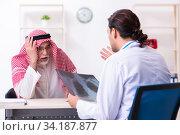 Купить «Old male arab visiting young male doctor», фото № 34187877, снято 16 августа 2019 г. (c) Elnur / Фотобанк Лори