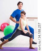 Купить «Fitness instructor helping sportsman during exercise», фото № 34188257, снято 10 июля 2018 г. (c) Elnur / Фотобанк Лори