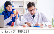 Dentist doctor and assistant working on new tooth implant. Стоковое фото, фотограф Elnur / Фотобанк Лори