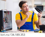Computer repair technician repairing hardware. Стоковое фото, фотограф Elnur / Фотобанк Лори