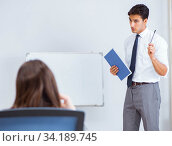 Купить «Business presentation in the office with man and woman», фото № 34189745, снято 7 августа 2017 г. (c) Elnur / Фотобанк Лори