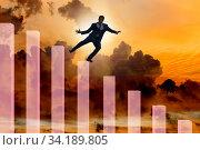 Crisis concept with declining chart. Стоковое фото, фотограф Elnur / Фотобанк Лори