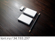 Купить «Blank business cards, pencils and eraser on wood table background. Branding mock up.», фото № 34193297, снято 10 июля 2020 г. (c) easy Fotostock / Фотобанк Лори