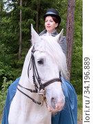 Купить «Young girl on a horse. Walking in the woods», фото № 34196889, снято 7 июня 2018 г. (c) Филатова Ирина / Фотобанк Лори