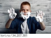Купить «Little boy with shaving foam on his face and hands», фото № 34207381, снято 9 июня 2020 г. (c) Tryapitsyn Sergiy / Фотобанк Лори