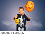 Boy in Halloween costume of skeleton and candy bin. Стоковое фото, фотограф Сергей Новиков / Фотобанк Лори