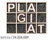 Купить «Collecting box Plywood letters on with black decoration sand representing the words PLAGIAT in broken notation in top view on white background. Sammelkasten...», фото № 34208689, снято 7 августа 2020 г. (c) age Fotostock / Фотобанк Лори