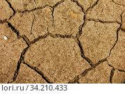 Купить «Cracked soil. Cracked mud representing drought or implying global warming», фото № 34210433, снято 14 июля 2020 г. (c) age Fotostock / Фотобанк Лори