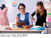 Купить «Young tailors working in workshop», фото № 34212897, снято 15 июля 2020 г. (c) easy Fotostock / Фотобанк Лори