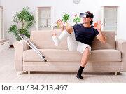 Купить «Leg injured young man suffering at home», фото № 34213497, снято 15 июля 2020 г. (c) easy Fotostock / Фотобанк Лори