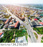 Купить «Aerial city view with crossroads, roads, houses, buildings, parks and parking lots. Copter drone helicopter shot. Panoramic wide angle image.», фото № 34216097, снято 15 июля 2020 г. (c) easy Fotostock / Фотобанк Лори