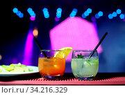 Купить «Assorted drinks of orange fernet lemon in the pub with the backlights», фото № 34216329, снято 6 августа 2020 г. (c) easy Fotostock / Фотобанк Лори