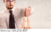 Купить «Young handsome businessman using wooden building blocks with white calculations scribbled around him», фото № 34216497, снято 7 августа 2020 г. (c) easy Fotostock / Фотобанк Лори