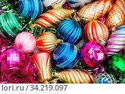 Купить «Colourful christmas decoration on a shiny background», фото № 34219097, снято 14 июля 2020 г. (c) easy Fotostock / Фотобанк Лори