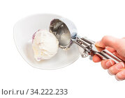 Putting ball of ice cream in bowl by disher scoop isolated on white backgrouns. Стоковое фото, фотограф Zoonar.com/Valery Voennyy / easy Fotostock / Фотобанк Лори