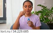 female beauty blogger making review of cosmetics. Стоковое видео, видеограф Syda Productions / Фотобанк Лори