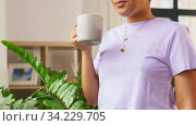 african american woman drinking coffee at home. Стоковое видео, видеограф Syda Productions / Фотобанк Лори