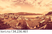 Sepia vintage retro image of the of hillside red tiled rooftop houses on the shore of Lake Ohrid, Northern Macedonia. Стоковое фото, фотограф Zoonar.com/Pawel Opaska / easy Fotostock / Фотобанк Лори