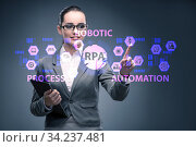 Businesswoman pressing buttons in RPA concept. Стоковое фото, фотограф Elnur / Фотобанк Лори