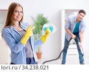 Young family cleaning the house. Стоковое фото, фотограф Elnur / Фотобанк Лори