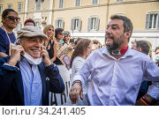 Italian actor Enrico Montesano (L) and leader of Lega party Matteo Salvini meet the demonstrators during the sit-in in front of Montecitorio Palace to... Редакционное фото, фотограф Alessandro Serrano' / AGF/Alessandro Serrano' / / age Fotostock / Фотобанк Лори