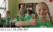 Girl wearing recycle symbol tshirt showing thumbs up. Стоковое видео, агентство Wavebreak Media / Фотобанк Лори