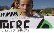 Girl with climate change sign in a protest. Стоковое видео, агентство Wavebreak Media / Фотобанк Лори