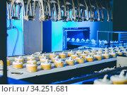 ice cream factory process making conveyor modern. Стоковое фото, фотограф Mark Agnor / Фотобанк Лори