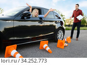 Student in car and instructor, all cones downed. Стоковое фото, фотограф Tryapitsyn Sergiy / Фотобанк Лори
