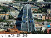 Купить «View of trucks driving over the new Genoa Bridge as part of a static test to examine the robustness of the structure ,Genoa,ITALY-19-07-2020.», фото № 34254209, снято 19 июля 2020 г. (c) age Fotostock / Фотобанк Лори